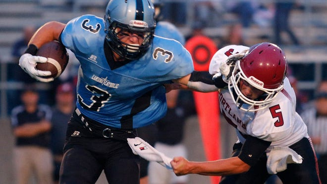 Tony Palmer, left, and Lansing Catholic could meet Cole McGregor and Portland in a Division 5 district final.