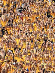 Iowa fans celebrate a touchdown during the Hawkeyes'
