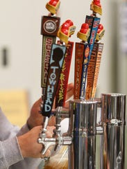 People sample a wide variety of beer and food from