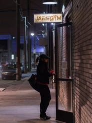 A member enters Jabs Gym on Winder Street off of Russel