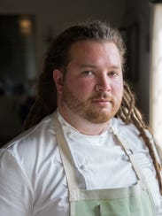 Chef Garrett Lipar poses for a photo at Marais Restaurant