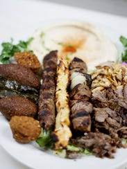 An Al-Ameer platter with grape leaves, fried kebbie,