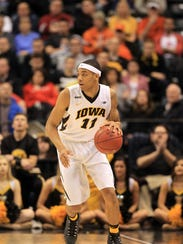 Iowa's Christian Williams takes the ball down court