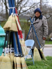 Jim Richter sells brooms, Monday at the corner of 71st