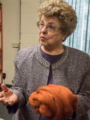 Roberta Rocho shows hand-spun wool at the Battle Creek