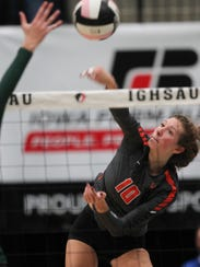 West Des Moines Valley's Madi Kubik goes for a kill