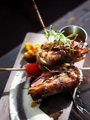 Grilled head-on prawns with compressed melon, lemon