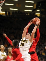 Iowa's Megan Gustafson pulls in a rebound during the