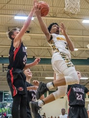 Pennfield's Ronald Jamierson (3) goes for the hoop