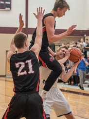Harper  Creek's Jon Taylor gets fouled by Marshall