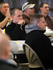 Members of local law enforcement agencies gather for