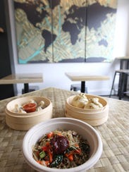 A sample of Dumpling Darling's menu is pictured on