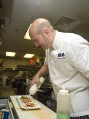 Chef and co-owner James Adrian puts the finishing touch