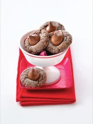 Rich fudgy chocolate kiss cookies are filled with tart