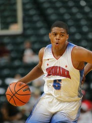 Indiana All-Star player Jarron Coleman (6) drives to