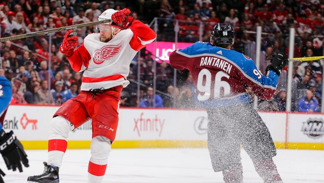 Detroit Red Wings defenseman Mike Green (25) and Colorado Avalanche right wing Mikko Rantanen (96) collide during the second period of an NHL hockey game Sunday, March 18, 2018, in Denver.