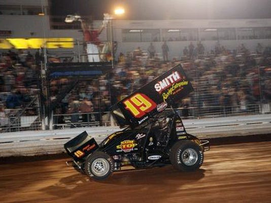 Stevie Smith takes the checkered flag Saturday night at Williams Grove Speedway to earn a 25,000 check for his victory at the World of Outlaws Summer Nationals.