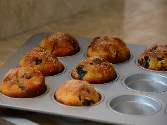 """Blueberry orange muffins from the Junior League of Pensacola Florida's cookbook """"Some Like it South!""""."""