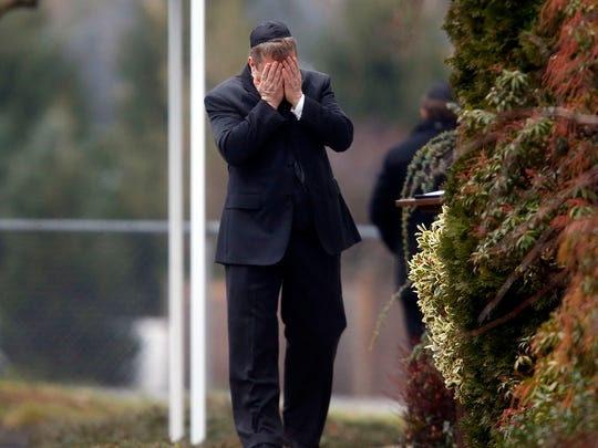 A mourner walks into a funeral service for 6-year-old