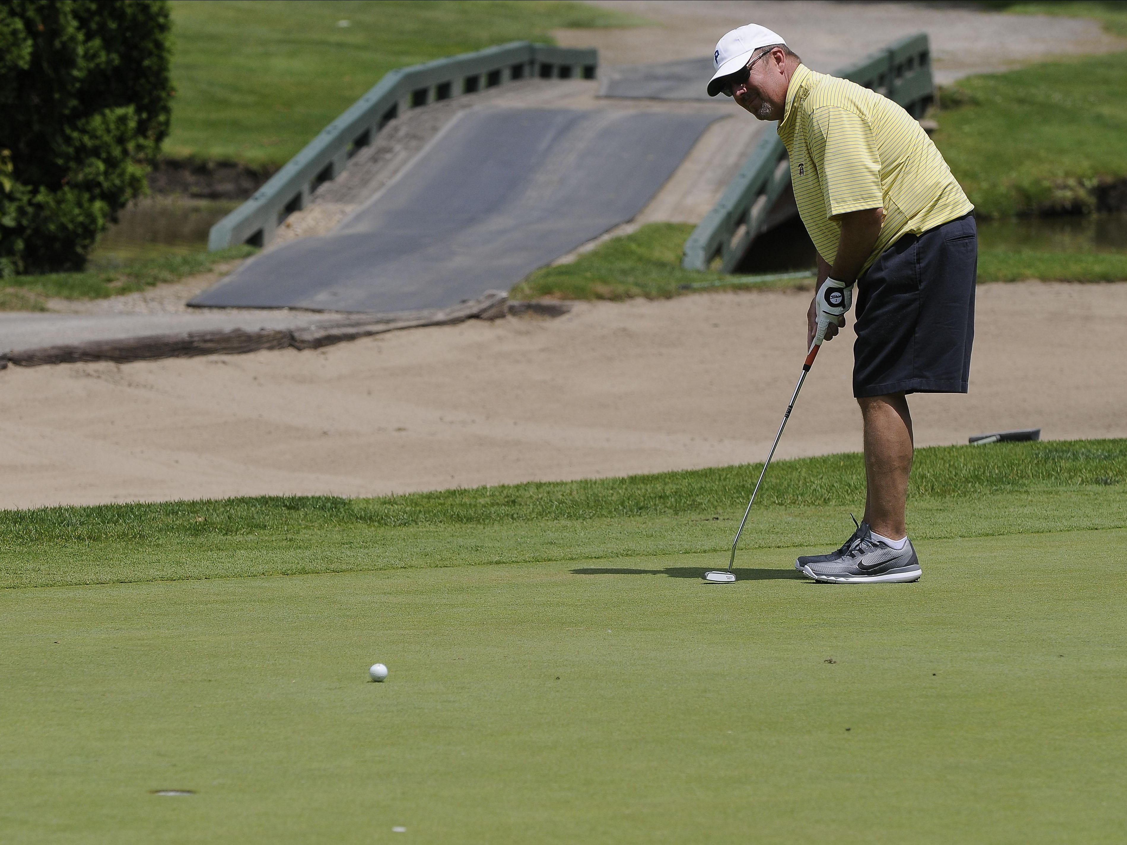 Markus Schulz putts the ball on the 18th green Friday, July 10 during the Port Huron Elks 2015 Men's Invitational in Port Huron Township.