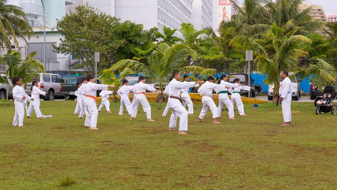 Karate students at a training session at Matapang Beach Park are shown in this file photo.