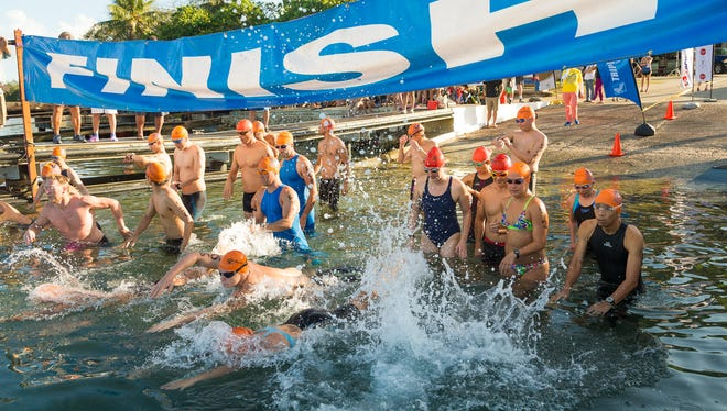 Competitors for the race start their swin during the annual Cocos Crossing Race held at Merizo Pier on May 29.