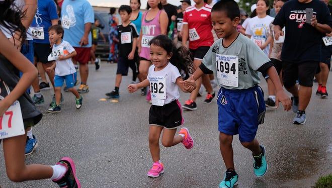 Children of all ages run at the Guam DOE Be Healthy Be Smart 2K/5K Fun Run at Tiyan Sept. 24.