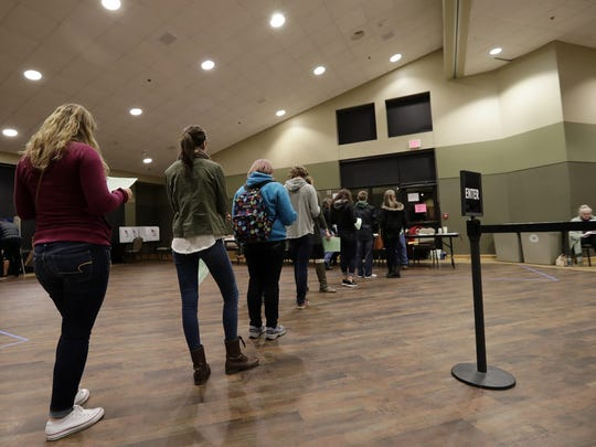 People stand in line to vote at the University of Wisconsin-Green Bay campus.