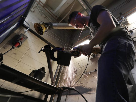 Brandon Hyde, 25, prepares a piece of metal for welding during a class at Northeast Wisconsin Technical College. After a downward spiral with drugs and alcohol, Hyde is turning his life around and learning a trade with help from his veterans-court mentor, former Brown County Sheriff Tom Hinz.