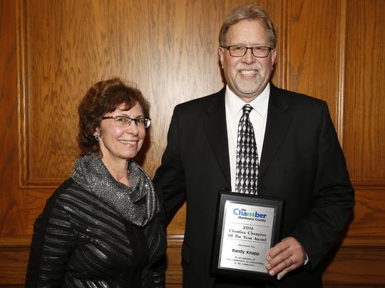 Sandy Hardrath (left) of Ansay & Associates poses with Colonial Pet Shot owner Randy Knapp after he won the Chamber's Champion of the Year award Wednesday, Feb. 7, in Mishicot.