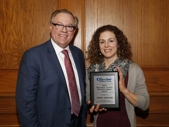 Silver Lake College's Chris Domes (left) presented the Chamber's Education Impact Award to Jessica Johnsrud of the Woodland Dunes Nature Center Wednesday, Feb. 7, in Mishicot.