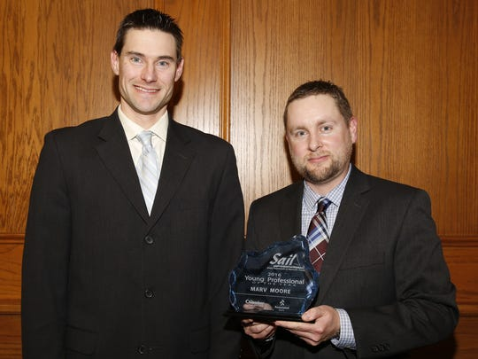 Josh Neeb (left) of Associated Bank presented the Chamber's award for Young Professional of the Year to Marv Moore of the Medicine Shoppe Wednesday, Feb. 7, in Mishicot.