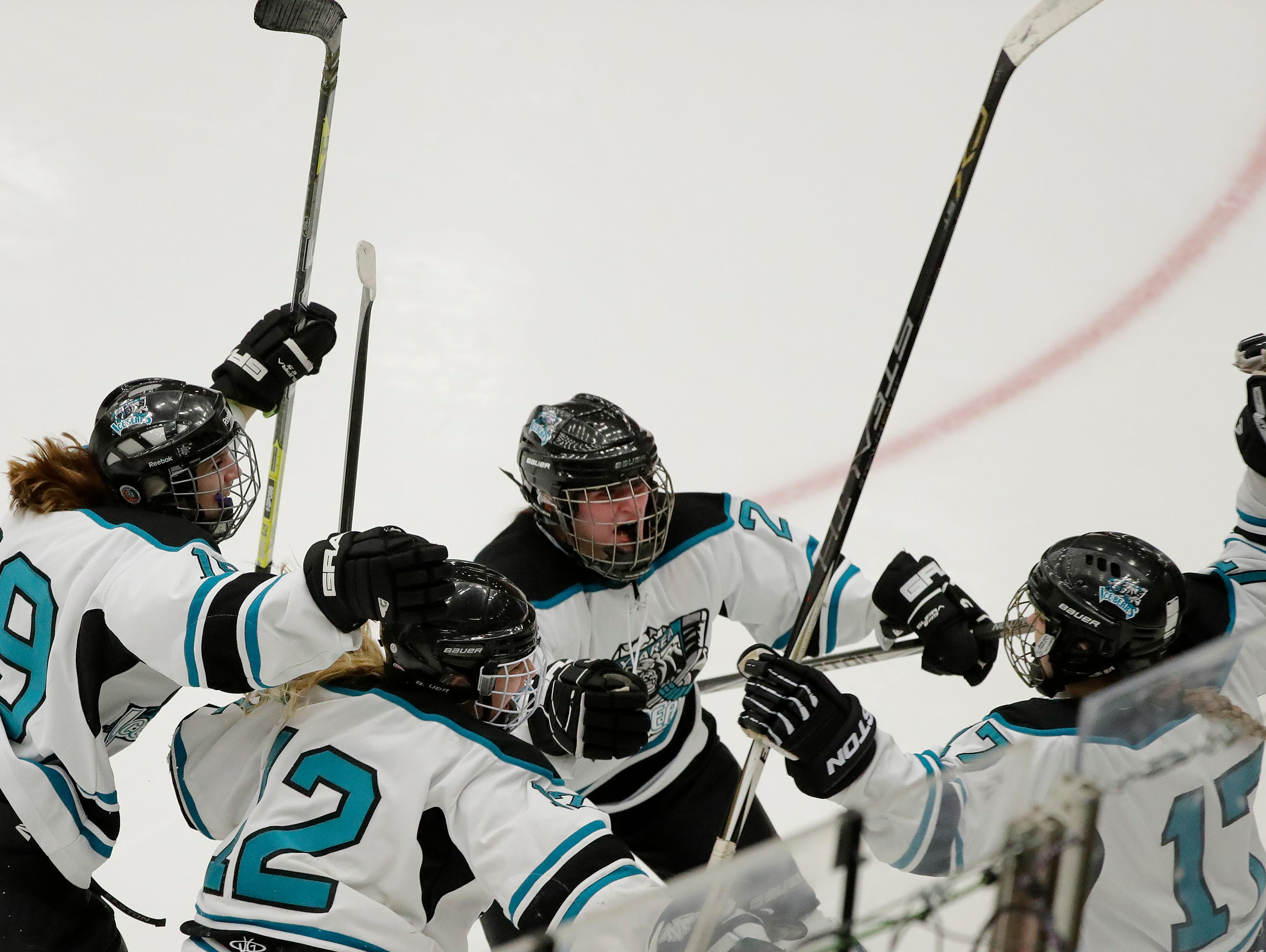 Bay Area Ice Bears players celebrate with forward Talia Boyea (17) (right) after Boyea scored against the Central Wisconsin Storm in the championship match at the 2017 State Hockey Tournament at Veterans Memorial Coliseum on Saturday, March 4, 2017, in Madison, Wis. The Storm won the match 2-1 in overtime. Adam Wesley/USA TODAY NETWORK-Wisconsin
