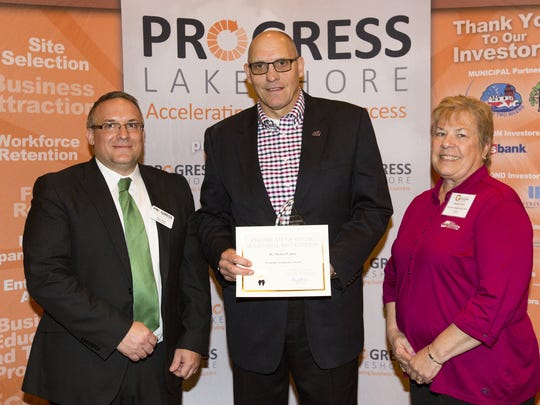 From left, Peter Wills, Dr. Michael Lanser and Bonnie Timm pose for a picture after Dr. Lanser won Progress Lakeshore's Economic Accelerator Award during the sixth annual Excellence in Economic Development Awards May 3 in Manitowoc.