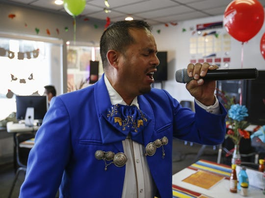 Mariachi singer Ramiro Gutierrez preforms at the grand opening of Paradise Food in Manitowoc.