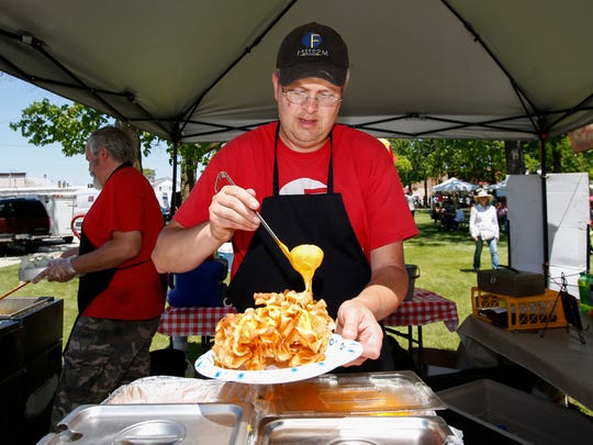 Eric Woller loads up a plate of butterfly fries with