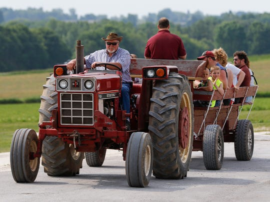 Lee Stefaniak, a retired farmer from Mishicot, gives a farm tour on his tractor at the Manitowoc County Breakfast on the Farm hosted by Habeck Homestead Farms Sunday, Jun. 11, 2017, in Maribel, Wis. Josh Clark/USA TODAY NETWORK-Wisconsin
