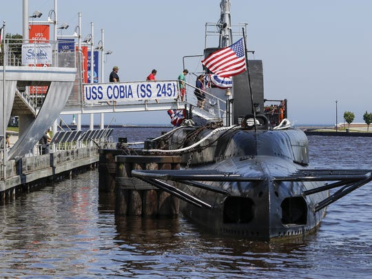 In this file photo, people board the USS Cobia in Manitowoc for self-guided tours with submarine veterans.