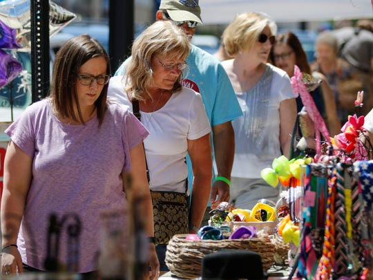 Shoppers peruse the offerings at the Krazy Daze sidewalk sale on 8th Street in downtown Manitowoc Saturday, Jul. 8, 2017, in Manitowoc, Wis. Josh Clark/USA TODAY NETWORK-Wisconsin