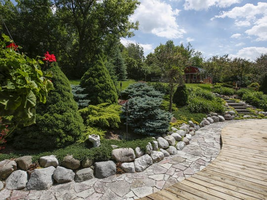 A stone walkway connects the patio to the back yard in the garden of Kris and Don Cisler June 21 in Manitowoc. The Cislers will be participating in the Manitowoc County Master Gardeners' Garden Walk scheduled for July 15.
