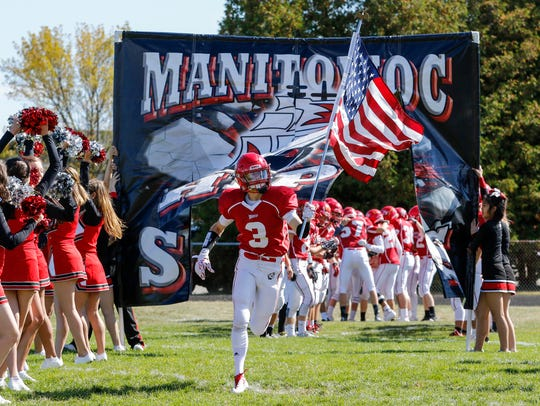 Manitowoc Lincoln's Tyler McDowell (3) runs with the