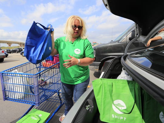 Shipt shopper Laura McKenna loads up her car with groceries for a Shipt customer at Meijer on Monday, August 28, 2017 in Green Bay, Wis.  Adam Wesley/USA TODAY NETWORK-Wisconsin