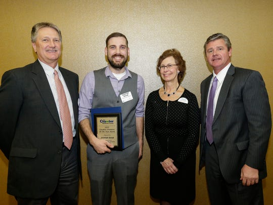 Jeremiah Novak, middle left, receives the Chamber Champion of the Year award presented by Scott Hansen, Sandy Hardrath and Tim Nelligan at the Chamber of Manitowoc County's 101st annual award dinner at the Holiday Inn Tuesday, Feb. 6, 2018, in Manitowoc, Wis. Josh Clark/USA TODAY NETWORK-Wisconsin