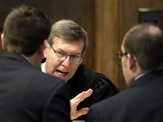 Brown County Circuit Court Judge John Zokowski talks to defense and prosecution lawyers Tuesday, during the trial of George Burch for the murder of Nicole VanderHeyden in May 2016.