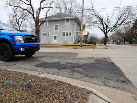 Vehicles drive along Webster Ave on Tuesday, March