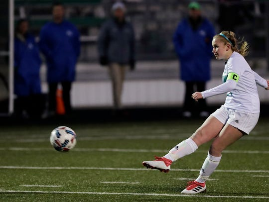 Green Bay Notre Dame's Trudy Quidzinski scores a goal from a free kick against Appleton North in an April 10 match.