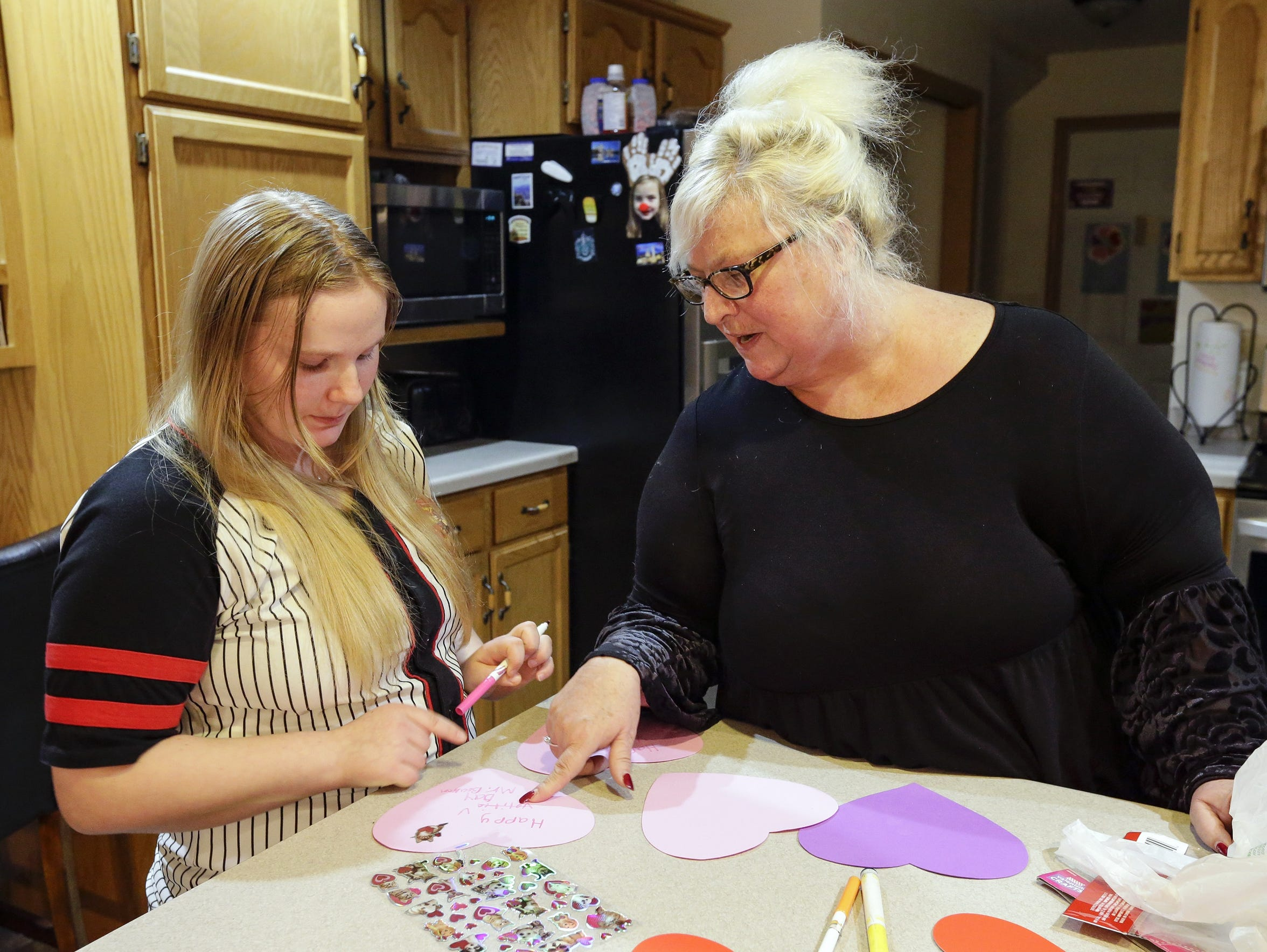 Becky helps her adopted daughter Danyell, 17, with