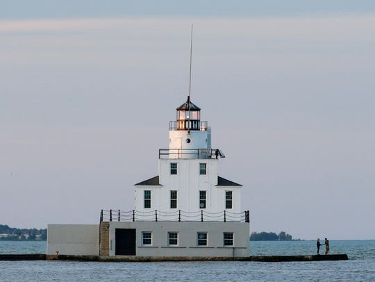 The sun sets on the lighthouse Monday, June 25, 2018,