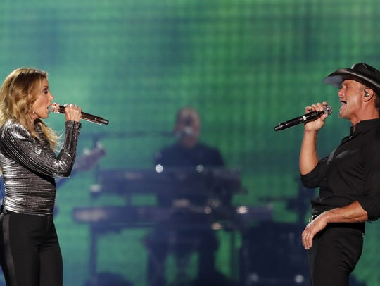 Country stars Faith Hill and Tim McGraw opened their