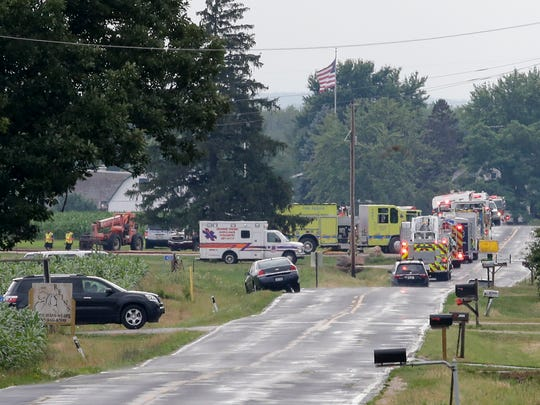 First responders on the scene of airplane crash off County Road O near the Sheboygan County Memorial Airport Friday, July 20, 2018, in Sheboygan Falls, Wis.